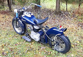 1948 dark blue bobber in autumn leafs